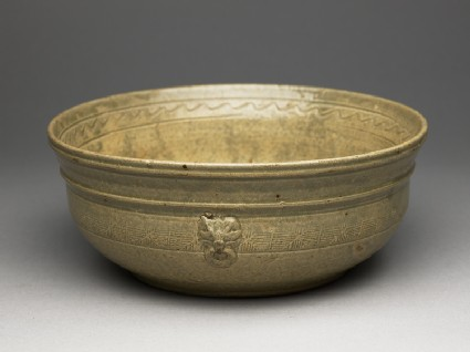Greenware bowl with bands of decoration