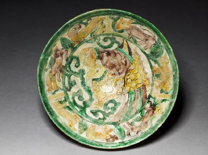 Bowl with two birds and running animals