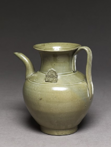 Greenware ewer with ornamental flanges