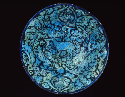 Bowl with animals against a foliate background