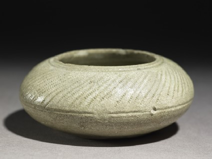 Greenware water pot with radial decoration