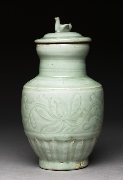 Greenware funerary vase with flowers and a bird