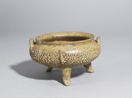 Greenware tripod bowl with impressed decoration