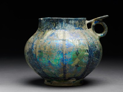 Cup with handle and thuluth inscription, scalloped pattern, and flowers