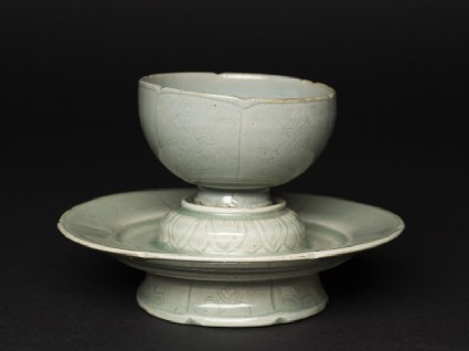 Greenware cup and stand with floral pattern