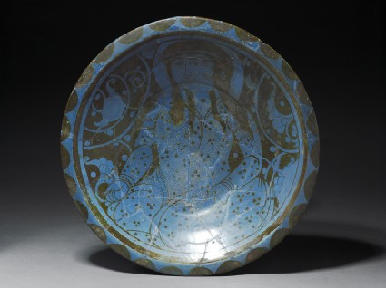 Dish with seated figure