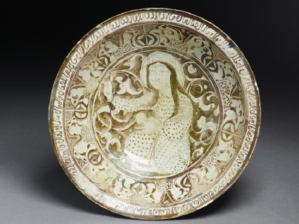 Dish with seated female figure against a foliate background