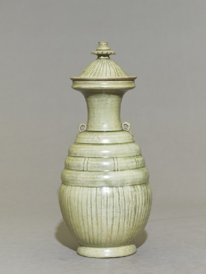 Greenware burial-pot with incised lines