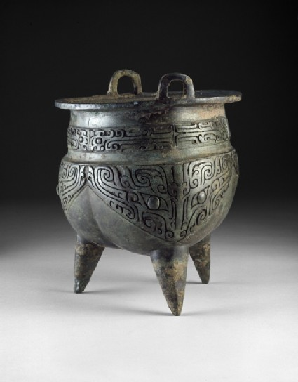 Ritual food vessel, or li ding, with taotie masks