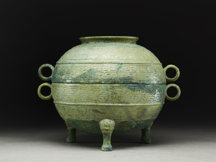 Ritual food vessel, or ding, with abstract and animal designs, and lid