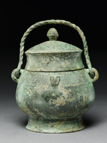 Ritual wine vessel, or you, with taotie masks and thunder-scroll pattern