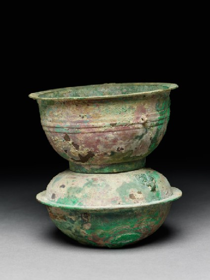 Ritual food vessel, or yan, with animal mask handles