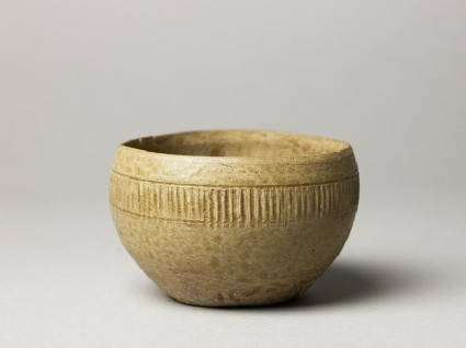 Greenware bowl with ribbed decoration