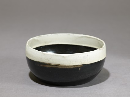 Black ware bowl with white rim