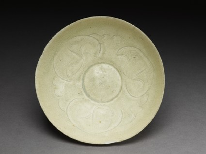 White ware bowl with stylized floral decoration