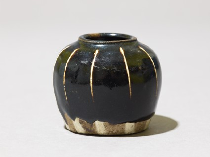 Black ware jarlet with white stripes