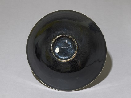 Black ware bowl with white interior and black exterior