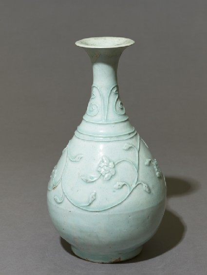 White ware vase with floral decoration