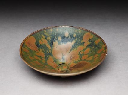 Black ware bowl with iron glazes