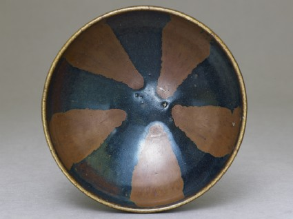 Black ware bowl with brown stripes
