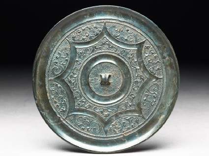 Ritual mirror with stylized dragons and phoenixes