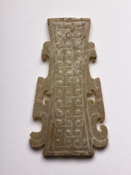 Pendant decorated with interlocking T-scrolls