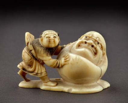 Netsuke in the form of a boy rolling a yuki daruma, or snowman