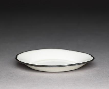 White ware dish with copper rim