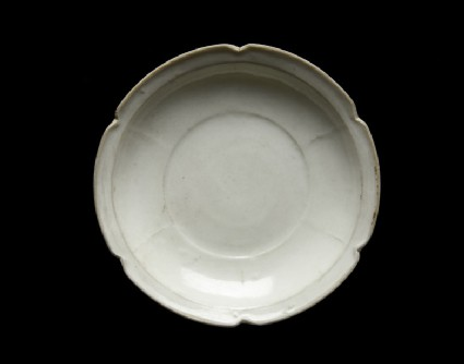 White ware dish with flattened and lobed rim