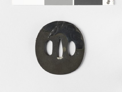 Round tsuba with a butterfly