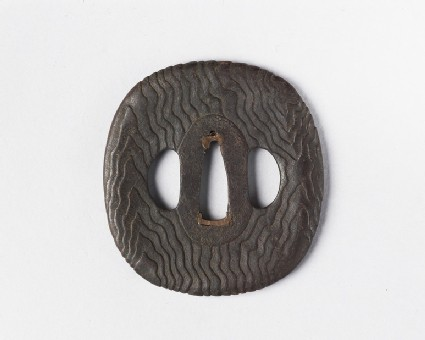 Round tsuba with wood grain