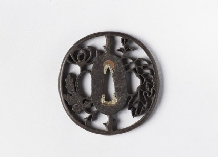 Round tsuba with a chrysanthemum