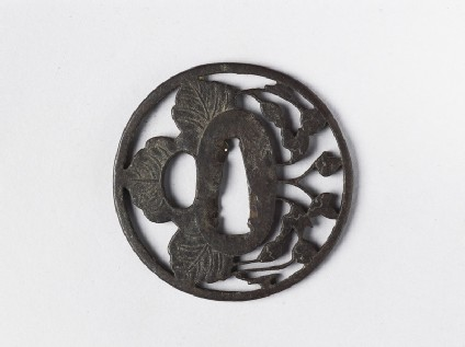 Round tsuba with a blossom