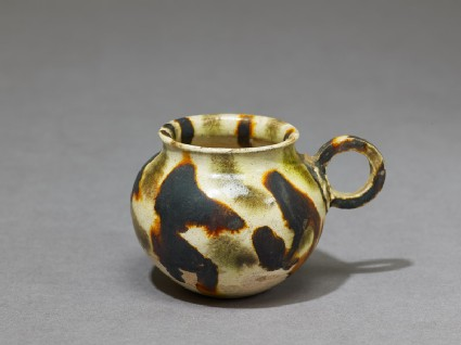 Cup with handle and three-colour glaze