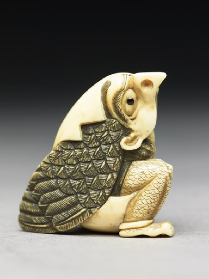 Netsuke in the form of a tengu mountain demon emerging from an egg