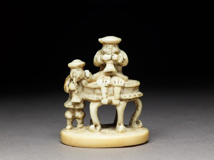 Netsuke in the form of two men playing wind instruments