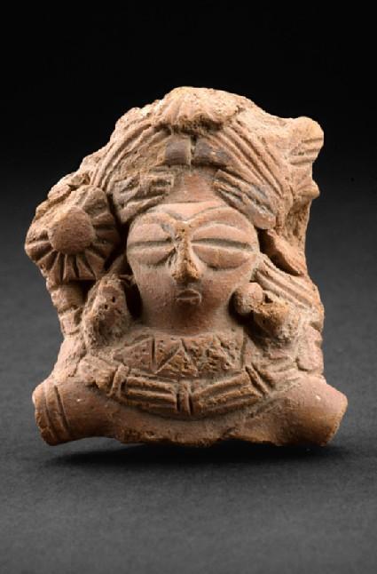 Bust of a female figure with elaborate headdress