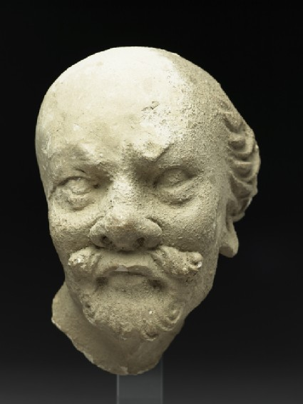 Stucco head of a man