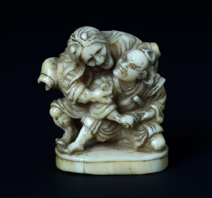 Netsuke in the form of Taira no Koremochi defending himself against a witch