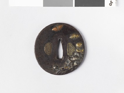 Round tsuba with design of peony flowers, rocks and butterflies