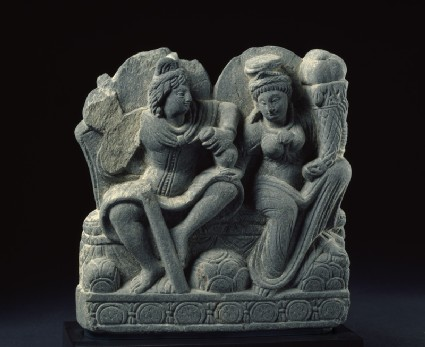 Relief depicting two deities with a staff, purse, and cornucopia