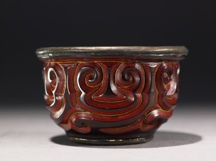 Cup with guri scrolling design