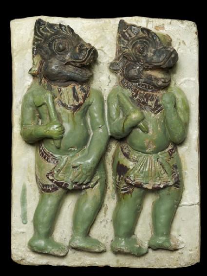Plaque with demon-headed warriors