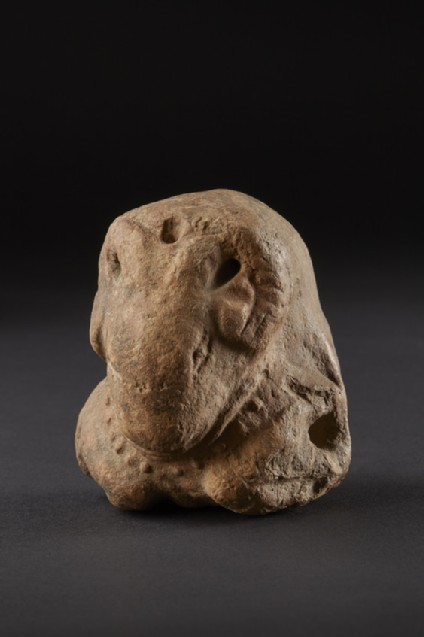 Figure of a ram or bull with sockets on the side, perhaps a toy