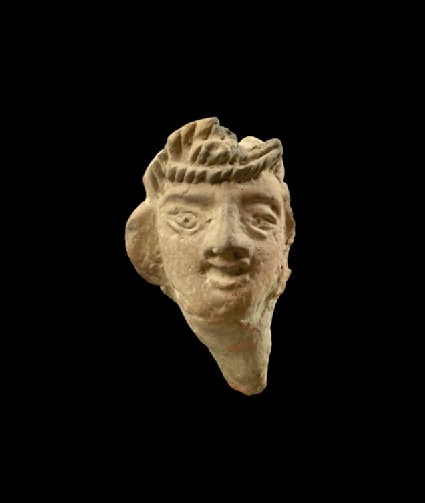 Fragmentary head of a figure, possibly female