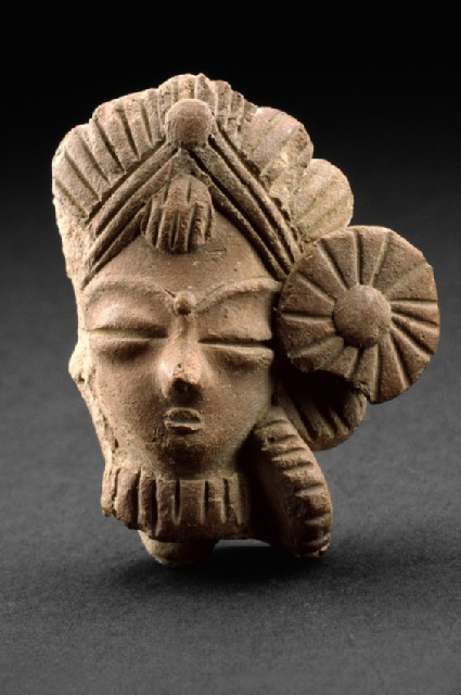 Figure of a female head with ornamentation