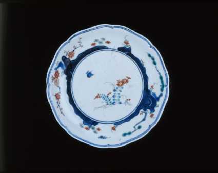 Plate with flowers, grasses, and trees