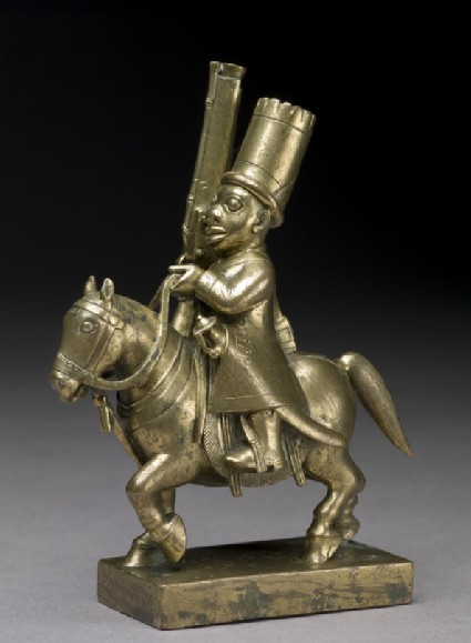 Toy soldier with horse and musket
