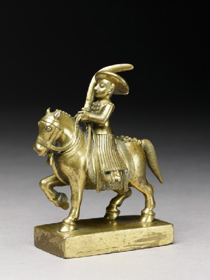 Toy soldier with horse and sabre