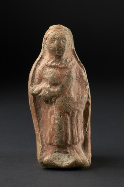 Standing figure, probably female, wearing a pleated garment
